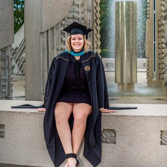 image of student sitting near fountain